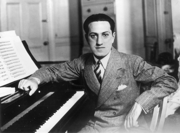 Songwriter George Gershwin (1898 - 1937) at a piano.   (Photo by Evening Standard/Getty Images)